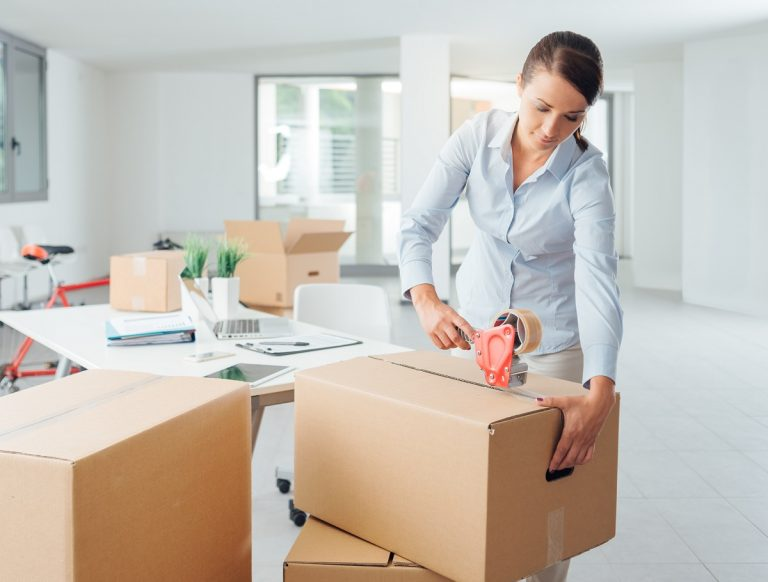 Woman packing in the office