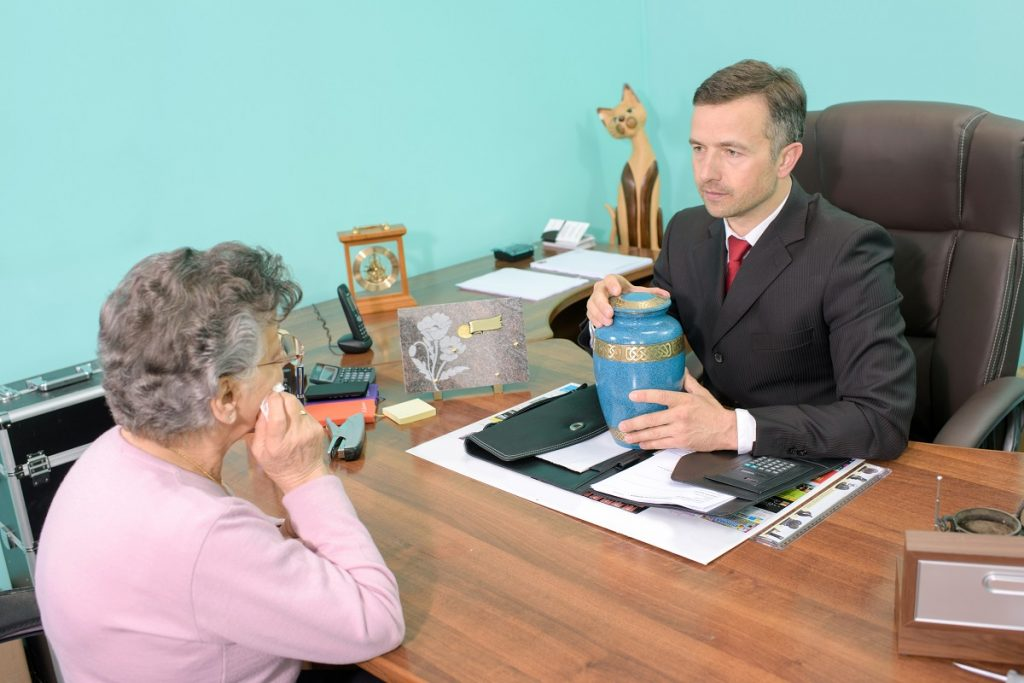 Woman talking to a funeral director