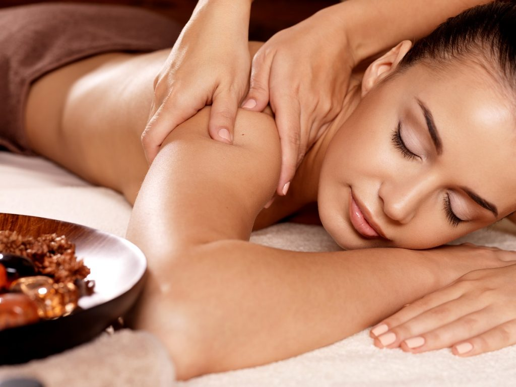 Woman rewarding herself with a spa treatment