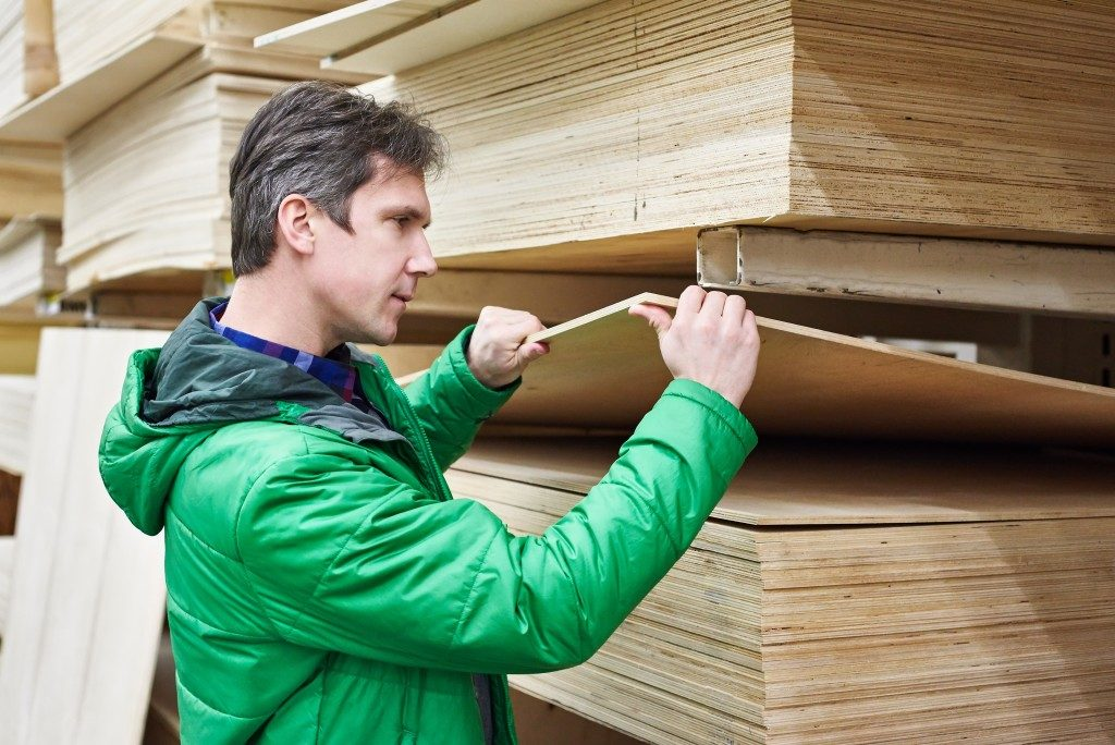 Man choosing a plywood